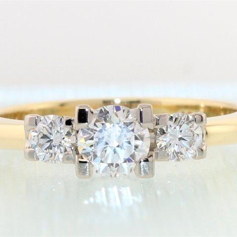 Three diamond claw set Ring