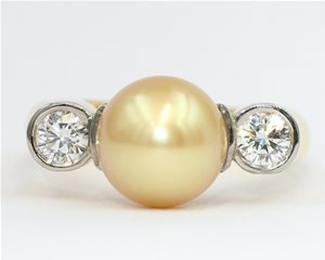 Yellow pearl and diamond ring