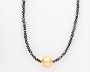 Yellow pearl on black diamond
